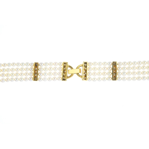 31 - An 18ct gold seed pearl and diamond bracelet. Comprising four seed pearl strands, gathered to a pave...
