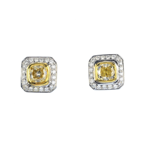 32 - A pair of 18ct gold 'coloured' diamond and diamond cluster earrings. Each designed as a cushion-shap...