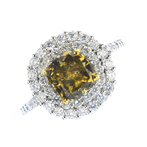 33 - A Fancy Dark Brown-Greenish Yellow diamond and diamond cluster ring. The cushion-cut Fancy Dark Brow...