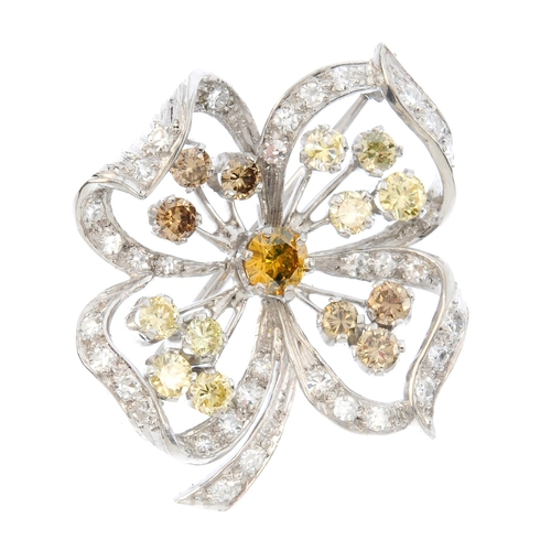 34 - A diamond and 'coloured' diamond brooch. Of openwork design, the brilliant-cut 'yellow' diamond, wit...