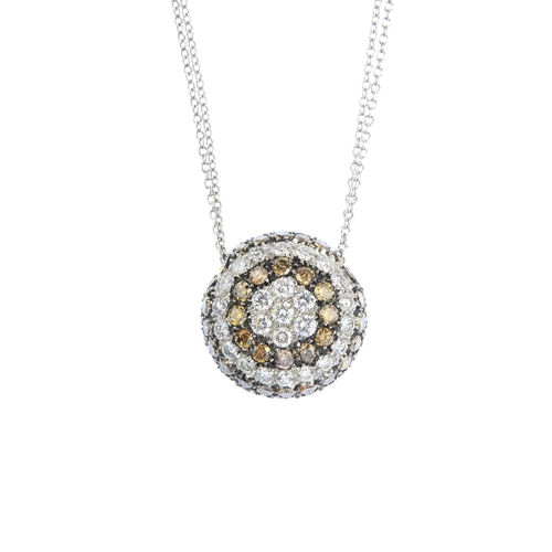 37 - A diamond and 'coloured' diamond pendant. Of bombe design, the brilliant-cut diamond cluster, within...