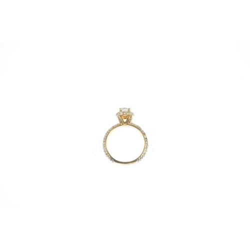 39 - A diamond single-stone ring. The brilliant-cut diamond and pave-set diamond surround, raised to the ...