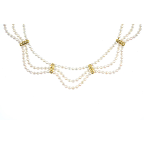 41 - An 18ct gold seed pearl and diamond necklace. Comprising three seed pearl, graduated, undulating str...