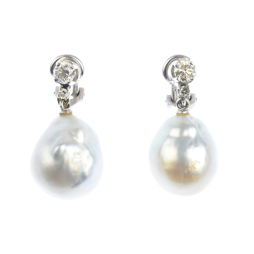 42 - A pair of cultured pearl and diamond earrings. Each designed as a baroque cultured pearl drop, suspe...