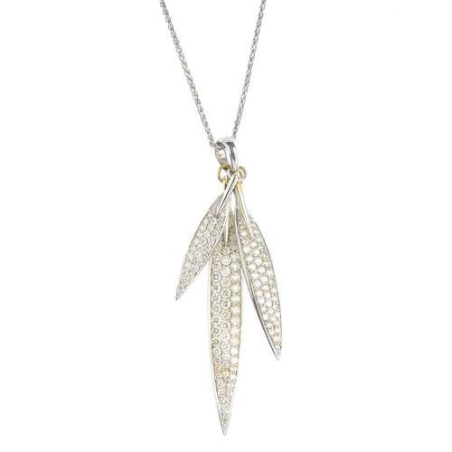 43 - A set of 18ct gold diamond jewellery. The pendant designed as three graduated, pave-set diamond feat...