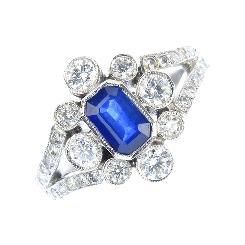 44 - A sapphire and diamond cluster ring. Designed as a rectangular-shape sapphire, with brilliant-cut di...