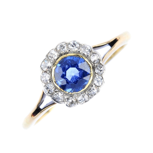 5 - An early 20th century 18ct gold sapphire and diamond cluster ring. The circular-shape sapphire, with...