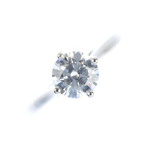50 - A platinum diamond single-stone ring. The brilliant-cut diamond, weighing 0.95ct, with tapered shoul...
