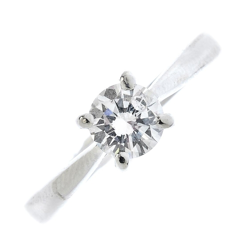 52 - A diamond single-stone ring. The brilliant-cut diamond, with tapered shoulders. Estimated diamond we...