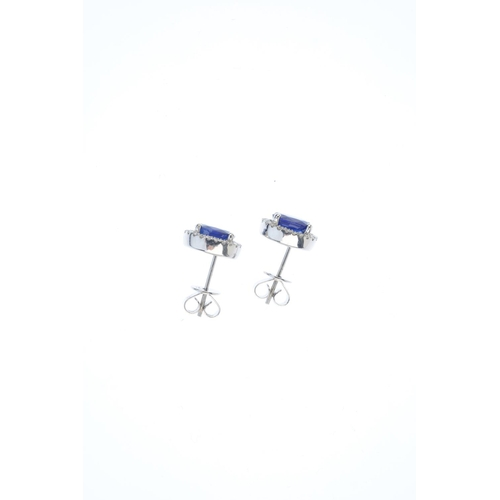 53 - A pair of sapphire and diamond cluster earrings. Each designed as an oval-shape sapphire, with brill...