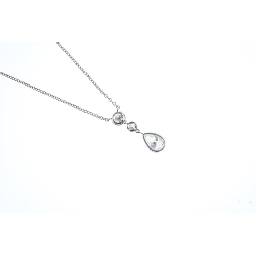 54 - A diamond pendant. The pear-shape diamond, suspended from a brilliant and old-cut diamond collet lin...