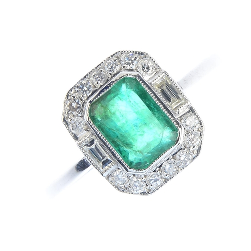 55 - An emerald and diamond dress ring. The rectangular-shape emerald, with brilliant and baguette-cut di...