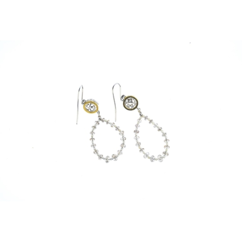57 - A pair of diamond and seed pearl earrings. Each designed as an alternating briolette diamond and see...