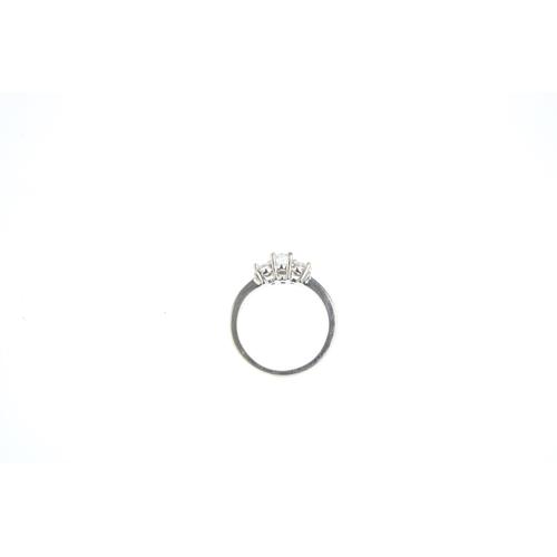 58 - A diamond three-stone ring. The oval-shape diamond, with similarly-shaped diamond sides. Estimated t...