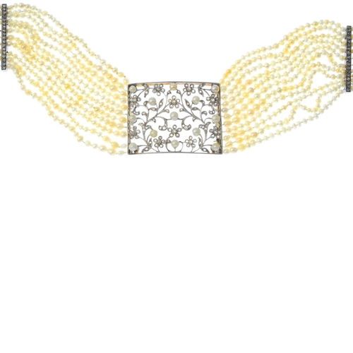 59 - A diamond, pearl and seed pearl choker. Designed as a rose-cut diamond and pearl scrolling floral cu...