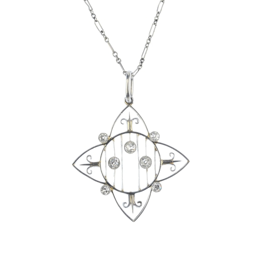 60 - An Edwardian platinum and diamond pendant. Of openwork design, the circular lattice, with stylised f...