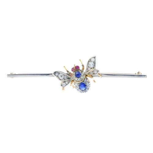 62 - An early 20th century gold, diamond and gem-set bee bar brooch. The graduated oval-shape sapphire an...