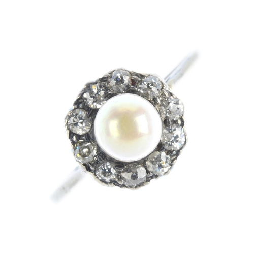63 - A pearl and diamond cluster ring. The pearl, measuring 5.5mms, with old-cut diamond scalloped surrou...