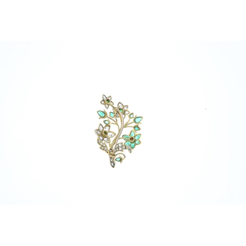 67 - An early 20th century gold emerald and diamond floral brooch. The circular and pear-shape emerald an...