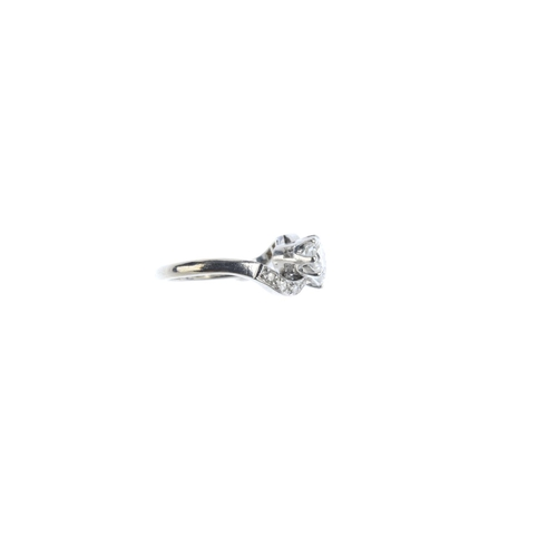 68 - A mid 20th century 18ct gold and platinum diamond two-stone crossover ring. The circular-cut diamond...