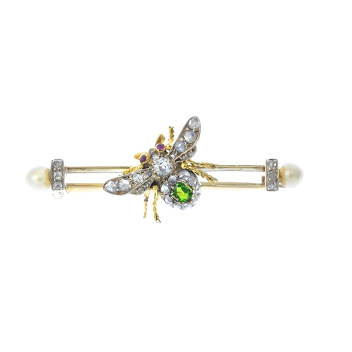 69 - A late Victorian gem-set bee brooch. The oval-shape green garnet and vari-cut diamond body, with cir...