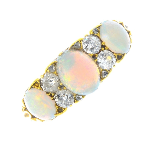 71 - A late Victorian 18ct gold opal and diamond three-stone ring. The graduated oval opal cabochon line,...