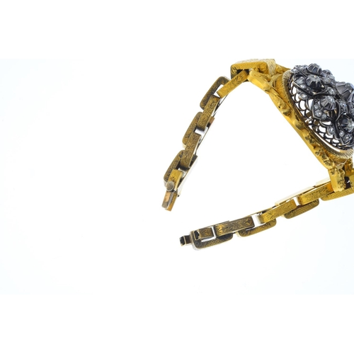 74 - A mid Victorian diamond bracelet. The old-cut diamond floral openwork centrepiece, detachable, to th...