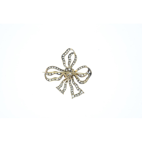 75 - A late Victorian silver and gold diamond bow brooch. Designed as an old-cut diamond cluster knot, wi...