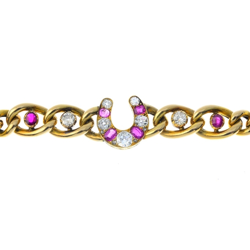 77 - A late Victorian gold, diamond and ruby horseshoe bracelet. The graduated alternate old-cut diamond ...