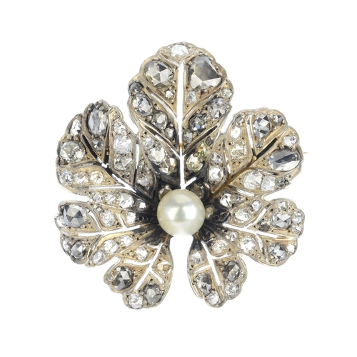 78 - An early 20th century silver and gold, cultured pearl and diamond brooch. The old and rose-cut diamo...