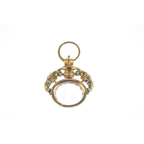 82 - A 19th century gold gem-set swivel seal. The oval-shape faceted rock crystal seal, rotating to the t...