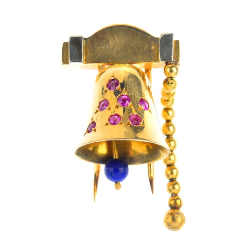 83 - LA CLOCHE - a mid 20th century ruby and lapis lazuli clip. Designed as a bell with circular-shape ru...