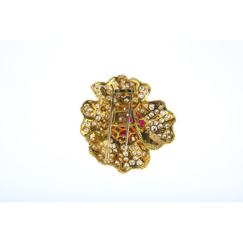 86 - A 1970s ruby and diamond floral brooch. The vari-size oval ruby cabochon cluster, to the brilliant-c...