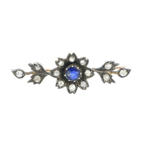 9 - A late Victorian silver and gold, sapphire and diamond brooch. The circular-shape sapphire and old-c...