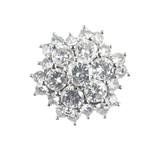 91 - An 18ct gold diamond cluster ring. The brilliant-cut diamond floral cluster, with similarly-cut diam...