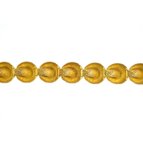 94 - A cultured pearl bracelet. Designed as a series of ten cultured pearls, each enclosed within a textu...