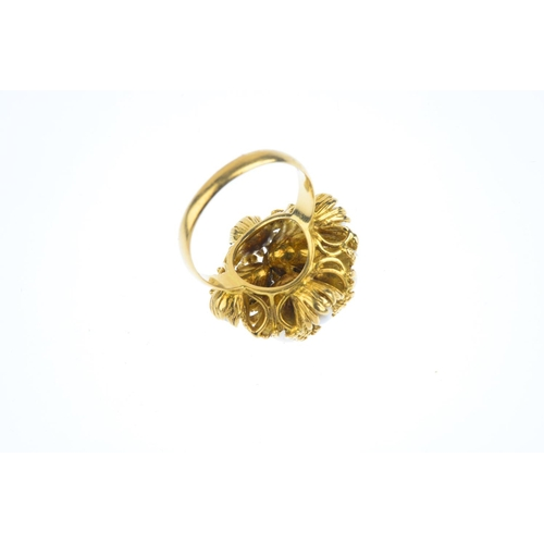 96 - A 1980s 14ct gold cultured pearl and diamond floral dress ring. Comprising a scattered series of var...