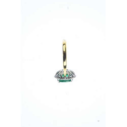 99 - An emerald and diamond cluster ring. The oval-shape emerald, with brilliant-cut diamond surround. Em...