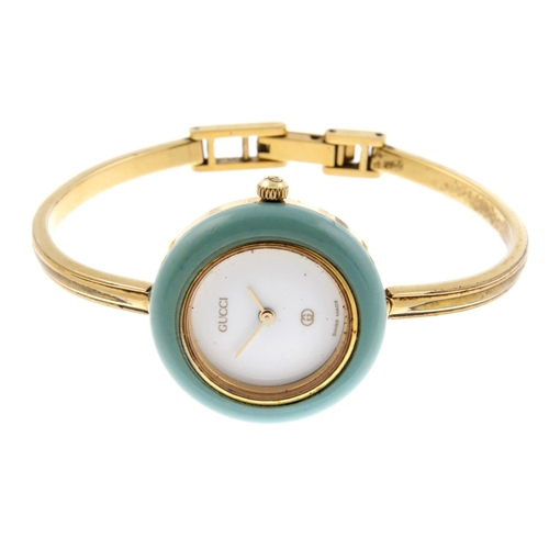552f9a87978 35 - GUCCI - a lady s 1100L bangle watch. Gold plated case with  interchangeable bezel