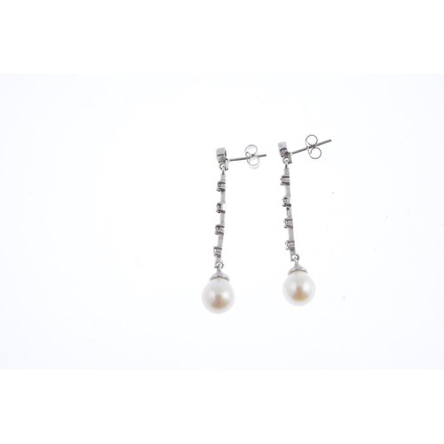 15 - A pair of cultured pearl and cubic zirconia earrings. Each designed as a cultured pearl, suspended f...