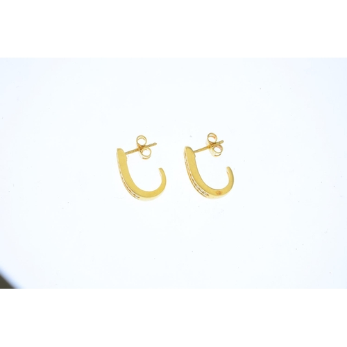 18 - A pair of 18ct gold diamond earrings. Each designed as a brilliant-cut diamond double line, within a...