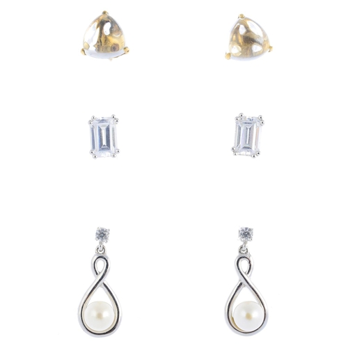 31 - Three pairs of gem-set earrings. To include a pair of rock crystal stud earrings, a pair of cultured...