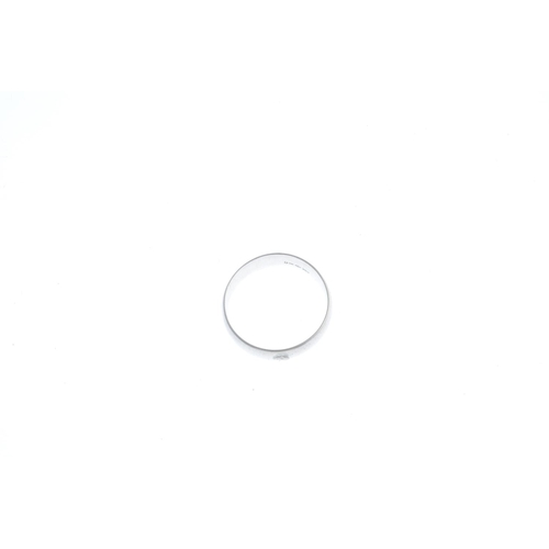 39 - A platinum band ring. Hallmarks for London. Ring size X. Width 5.9mms. Weight 9.5gms....