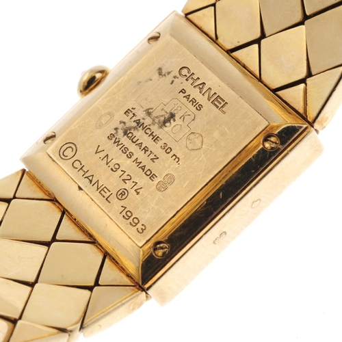 44 - CHANEL - a lady's Matelassé bracelet watch. 18ct yellow gold case. Numbered V.N.91214. Unsigned quar...