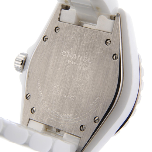 46 - CHANEL - a lady's J12 bracelet watch. Ceramic case with calibrated bezel and stainless steel case ba...