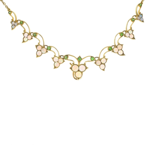 15 - An early 20th century 15ct gold opal and demantoid garnet necklace. The opal cabochon graduated foli...