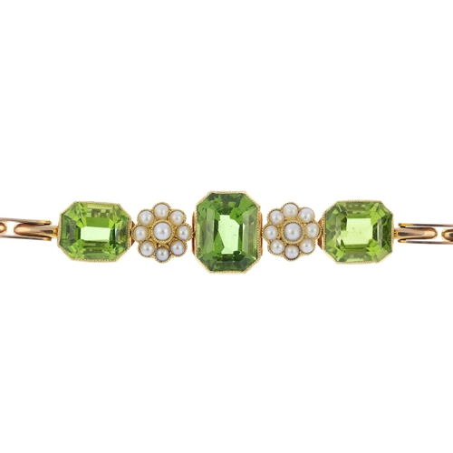 23 - An early 20th century gold, peridot and split pearl bracelet. Designed as a rectangular-shape perido...