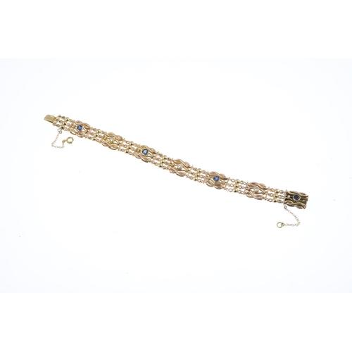30 - A sapphire and diamond bracelet. Designed as an alternating circular-shape sapphire and old-cut diam...