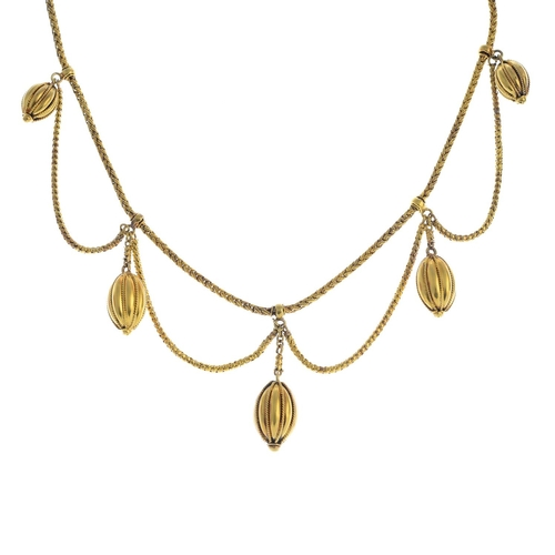 46 - A late Victorian gold necklace. Designed as a series of rope-twist and grooved drops, with snake-lin...
