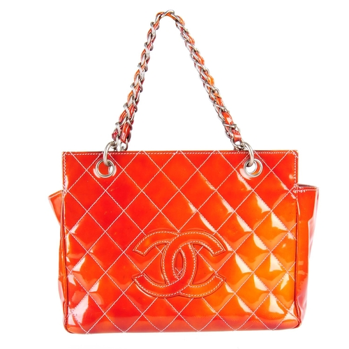 5181d842eda0 58 - CHANEL - a Petite Timeless Tote. Crafted from burnt orange patent  leather with